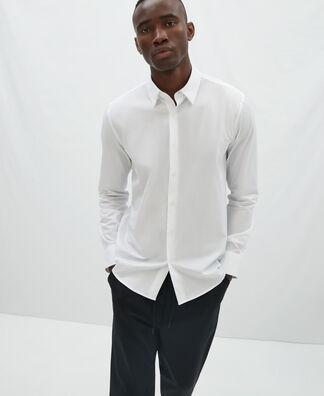Camisa de algodón con botón oculto