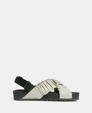 Rubber and leather crossed sandal